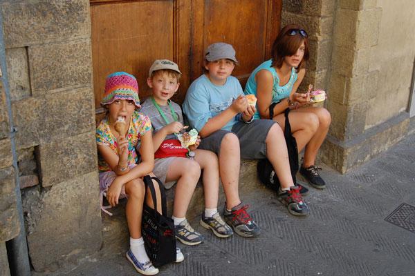 Kimmy, Robert, Joshua and Becky sampling gelato near Ponte Vecchio in Florence