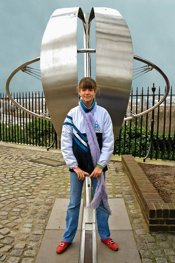 Straddling Prime Meridian, Greenwich, England