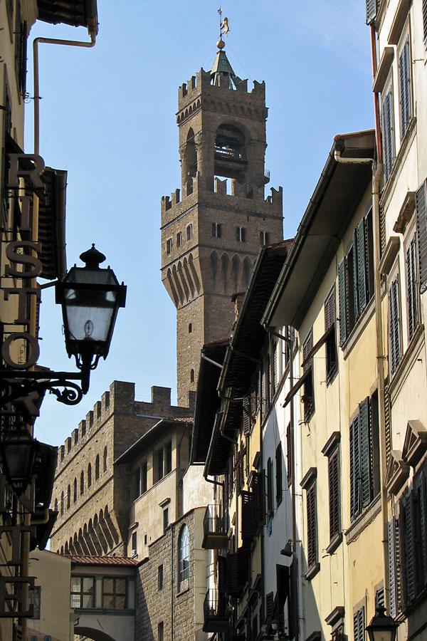 Palazzo Vecchio glimpsed from a Florentine street