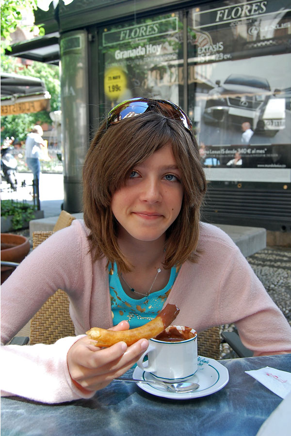 Enjoying churros con chocolate in Granada